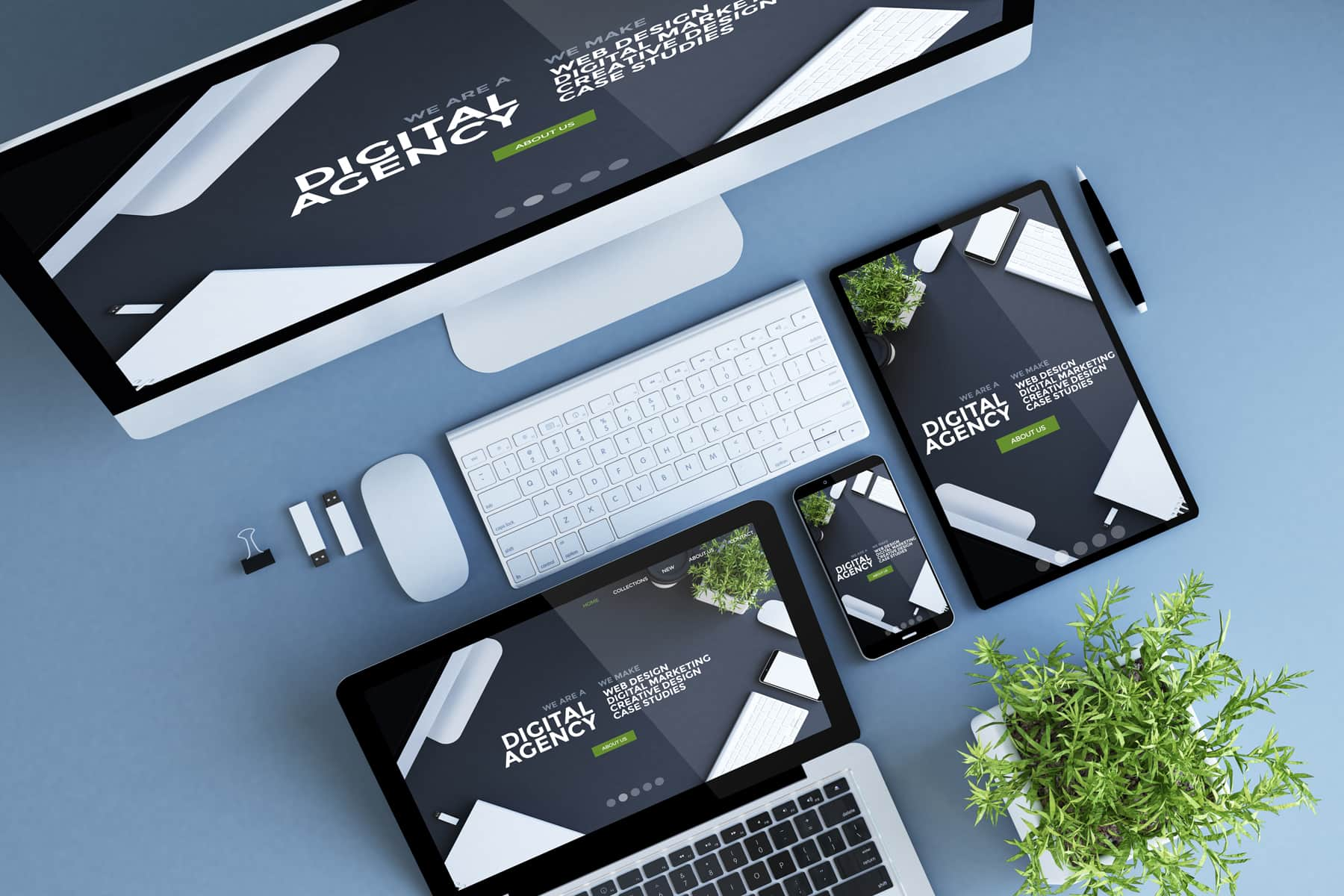 Four different devices show a responsive web design on their screens and words that describe a digital marketing company.