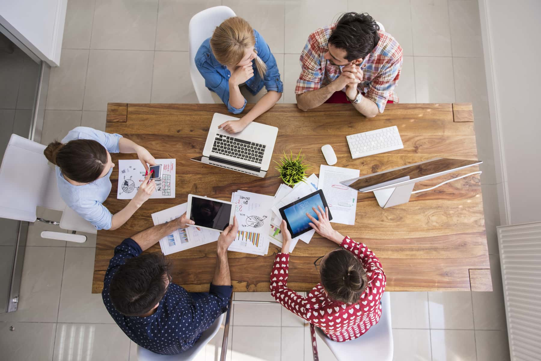 Top view of a digital marketing company team having a meeting at their office.