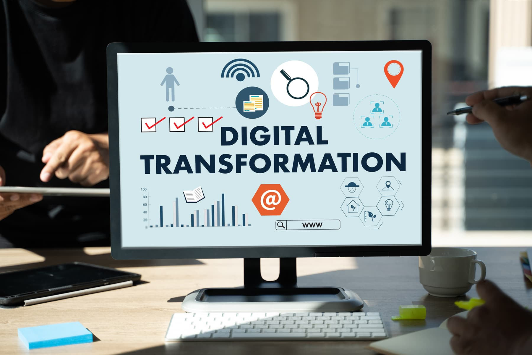 """Close view of a desktop screen with big, bold letters """"digital transformation"""" and many icons representing all the digital ways marketing agencies Toronto can use to support small businesses."""
